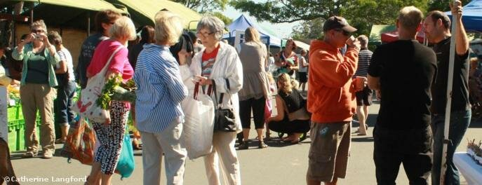 Socialising at the Sunday market in Kerikeri